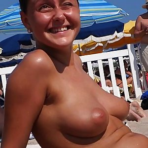 spectacular babes with big natural tits out on public beach