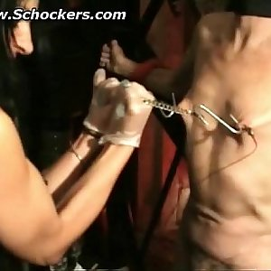 Mistress big fake tits pulls on meat hooks and spanks a sub hard on his ass bdsm