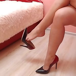 Dangling with beautiful high heel shoes.