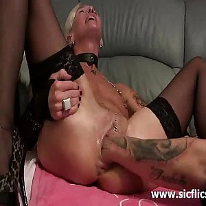 Fiercely Fisting her massive snatch till it squirts